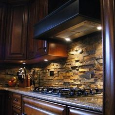 Stone Backsplash - that's fun! like this and the cabinet color