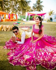 6 Non-Cheesy Ways To Coordinate Bride & Groom Outfits! – UrbanClap Sponsored Sponsored 6 Non-Cheesy Ways To Coordinate Bride & Mehndi Outfit, Pink Lehenga, Bridal Lehenga, Bollywood Lehenga, Saree, Bridal Mehndi, Bollywood Style, Peach Gown, Haldi Ceremony