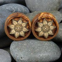 """Organic Exotic Olive Wood Plugs Gauges Mandala Laser Inlay 0 gauge to 2"""" Proudly Made in the USA. Now available on our website! Modifika This Pair of Exotic Organic Olive Wood Plugs feature a beautiful laser cut inlayed American Holly."""
