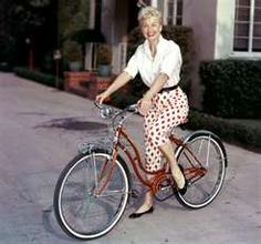 ... Doris Day is snapped looking carefree on a red Schwinn bicycle in 1955
