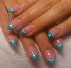Turquoise french manicure design with white dots. Simple and clean design for short nails.