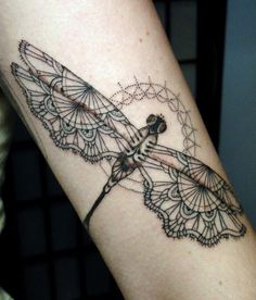 Black and white Dragonfly tattoo on leg
