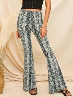 Color: MulticolorFabric: Fabric is very stretchyFit Type: RegularComposition: Polyester, SpandexPant Length: LongPant Type: Flare LegPattern Type: Snakeskin PrintSeason: Spring/FallStyle: ElegantWaist Type: Mid Waist Flare Leg Pants, Wide Leg Pants, Spandex Pants, Spandex Fabric, Fall Pants, Type Of Pants, Pants For Women, Clothes For Women, Drawstring Pants