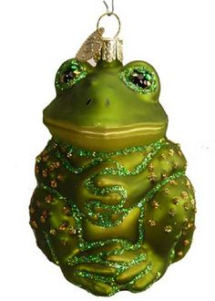 """Sitting Frog. Glass Christmas Ornament Merck Family's Old World Christmas 12221 This Sitting Frog is very cute! It has sparkling gold dots all over. He is about 3"""" in ht and 2"""" in width."""