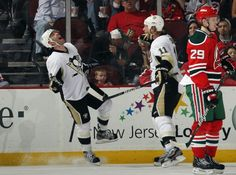 Pascal Dupuis and Jordan Staal after a goal by #9