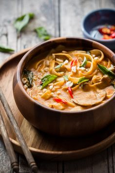 Creamy, comforting spicy thai curry pumpkin noodle soup gets ready in 20 minutes and the recipe takes you back to Thailand!