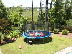 trampoline filled with beach balls, pool, and waterslide were fun elements of the party