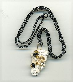 Handmade wire wrapped white shell pendant accented with black beads, clear gold seed beads on a black chain. by CraftyClosetCreation on Etsy