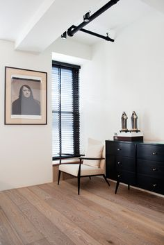 Tour an Airy New York City Loft That Mixes Old and New Designed by P&T Interiors Posted July 23, 2014 in Top Designers At Work by Dering Hall A photo by Julian Schnabl hangs on the wall above a vintage armchair and dresser in black by Paul Mccobb.