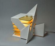 folding light - Created with an architectural inspiration, the 'Folding Light' by Michael Jantzen features fragmented sections that can be opened and c...