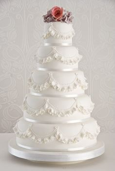 'Ruffle' wedding cake : A very pretty ivory wedding cake  decorated with hand crafted sugar ruffles.