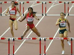 Switzerland's Lea Sprunger, United States' Cassandra Tate and South Africa's Wenda Nel, from left, compete in the women's 400m hurdles.  Ng Han Guan, AP