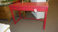 SOLD - Painted red desk or table - two drawers - distressed and a tinted wax hand applied. ***** In Booth D16 at Main Street Antique Mall 7260 E Main St (east of Power RD on MAIN STREET) Mesa Az 85207 **** Open 7 days a week 10:00AM-5:30PM **** Call for more information 480 924 1122 **** We Accept cash, debit, VISA, Mastercard, Discover or American Express