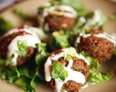 Photo: Falafel with Garlicky Tahini Sauce Recipe The kitchen (The Home of Delicious Arabic Food Recipes) invites you to try Falafel with Garlicky Tahini Sauce Recipe. Enjoy the good taste of Arabic Food and learn . Falafels, Cookbook Recipes, Cooking Recipes, Cooking Tips, Vegetarian Recipes, Healthy Recipes, Rice Recipes, Delicious Recipes, Tasty