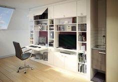 Le mur entier est recouvert de rangements pour une pièce multifonction. Bureau, salon, bibliothèque, cuisine, on ne sait plus où donner de la tête.
