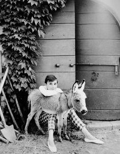 Audrey Hapburn and her cute donkey