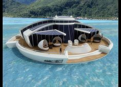 Floating, solar-powered yacht/hotel/submarine that can essentially be plopped down near existing water-front hotels or marinas... by Italian Industrial Designer, Michele Puzzolante.