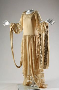 """Wedding Dress, Jeanne Lanvin (1867-1946), Paris, France: 1924, silk crepe, lace, lam, pearls, net. """"This Renaissance-style dress was worn by the donor, née Janet Lawrence, on the occasion of her marriage to Robert McCormick Adams on May 3, 1924 at St. James Episcopal Church in Chicago, followed...The wedding gown was ordered from Lanvin in Paris by the bride's mother through Madame Marguerite Pick's Michigan Avenue salon in Chicago. A sketch of this dress was featured in American Vogue."""""""