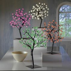 Lit Cherry Tree from Midnight Velvet. Inspired by a real cherry tree bathed in the day's first rays of sun, this enchanting specimen glows with the twinkle of LED lights. Even better, this tree requires no pruning or watering—just plug it in and enjoy.