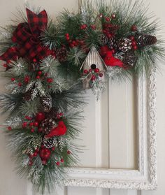Snowy Christmas Frame Wreath ..With Red Birds and Birdhouse. Antique White Frame Chalk Paint...Measures 16 x 20. Finished Wreath Size Approximately 21 x 24. Covered with Greenery..Pine..Pine Cones...Berries...Cardinals a Cute Corrugated Birdhouse. Greenery Adorned with Apples and Pears.. This Wreath can be used during the Winter and During the Holidays. Thank you for stopping by. Please be sure to check out my store for other items that may be available. Happy Holidays