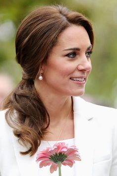Kate wore her hair in a low ponytail for her visit to Victoria, Canada on October 1, 2016.