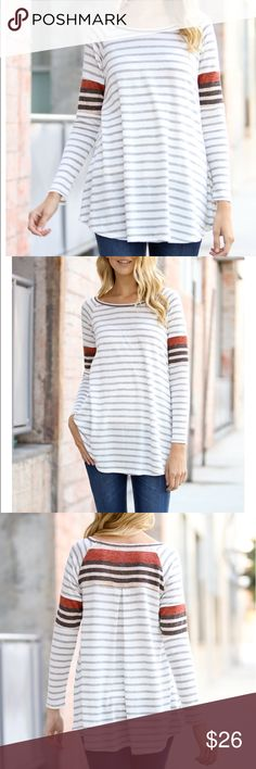 """Striped Long Sleeve Top This long sleeve top is versatile ! Mix and match your favorite accessories to create a fashionable outfit. Love the color block stripes on the sleeves and back.  ❗❗1 of the larges has blue strip on the back   Medium measurements  Bust: 42"""" Length: 30""""  56% rayon / 15% polyester / 15% cotton Bewitched Boutique Tops Tees - Long Sleeve"""