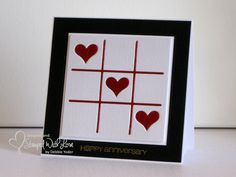 handmade anniversary card: 3-in-a-row = WINNER! ... black and white with shine red die cuts ... tic tac toe board with hearts ... framed look ... square format ... great card!!