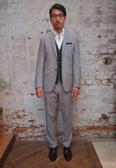 Armstrong and Wilson Pocketsquare: $85 Stones Plaid Vest: $195 Hilton Notch Lapel Wool Suit: $898