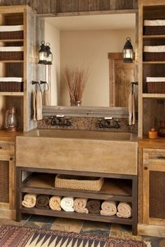 Rustic bathroom.  I like the double apron sinks color. I like the hardware.  And the shelving. Hate the rug.