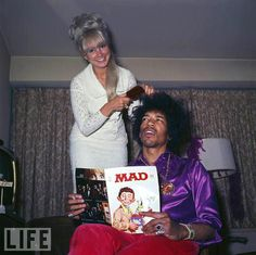 Combing Jimi Hendrix's hair, c.1969 -He's reading a MAD magazine, love it.