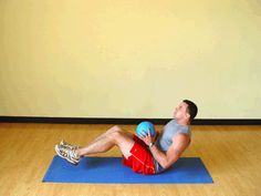 Today's Exercise: Balancing Seated Torso Twists with Medicine Ball