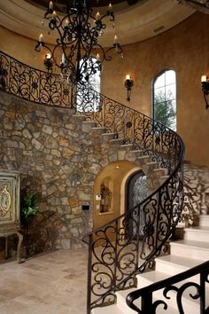 Turret, barrel entryway with curved staircase overhead.Rustic charm in a stone-clad staircase with iron stair rail. Curved Staircase, Staircase Design, Rich Home, Italian Home, Tuscan House, Mansions For Sale, Mediterranean Homes, Stone Houses, Luxury Real Estate