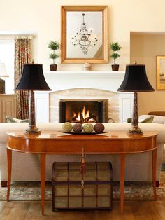 Behind Sofa Table for Your Living Room : Traditional Family Room With Comely Beige Sofa Color Also Wooden Behind Couch Table Also Charming Black Table Lamps Also Treasure Case Ornament Also Classic Fireplace Design With Elegant White Mantelpiece