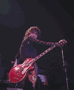 http://custard-pie.com/ Jimmy Page theremin-ing and smiling at Robert (click image for great gif)