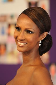 Iman looks fab with hair pulled into bun at nape of neck.  Gorgeous 50+ woman, very classy.