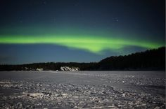 Finland Northern Lights over a frozen lake