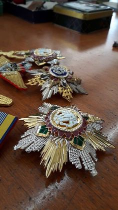 The star of the Knight Grand Cordon (Special Class) of the Most Exalted Order of the White Elephant and the Most Noble Order of the Crown of Thailand.