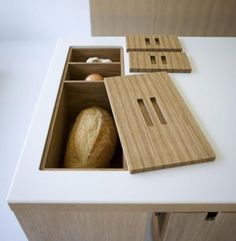 Sometimes I come across a detail in a kitchen and it just strikes an aha moment. That's the way I felt when came across a built-in countertop bread box (pictured above) — it got me thinking about all the other things you could store in your countertop. Here are a few favorite ideas.