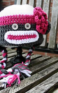 Freakin' adorable!  Made using pattern I repinned from Pinterest...found here:  http://paperdandelions.blogspot.com/2011/08/toddler-sized-sock-monkey-hat-girl.html