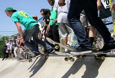 Boarders practice in between the competition divisions during the Philly Amateur Skateboarding Competition at Ambler Skate Plaza. Gazette staff photo by BOB RAINES