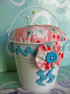 cute bucket pincushion- imagine making the pincushion part with a tab to remove it for storage underneath