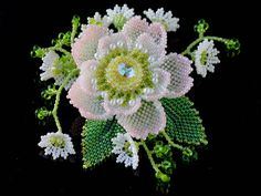 Beadwoven brooch by Handmade Beaded Corsage, a Japanese maker of fine beaded pieces.