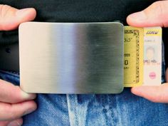 The Smart Belt Buckle is a unique alternative to carrying a wallet. It features a hidden storage chamber for holding up to 3 credit cards plus cash inside. GetdatGadget.com/smart-belt-buckle-holds-pants-holds-cash-cards/