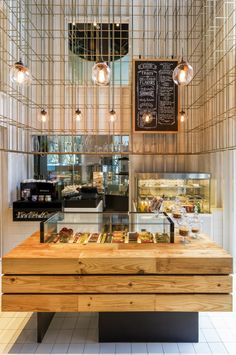 Shenzhen+Deli+/+Linehouse- grid over the walls with natural wood makes a multidimensional modern yet warm statement!
