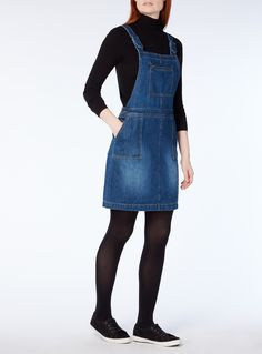 A stylish layering option for your seasonal collection, this dark denim pinafore dress is crafted purely in natural cotton.  Dark denim pinafore Adjustable straps Zip chest pocket Side button fastenings Functional pockets Model's height is 5'11
