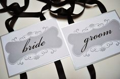 Bride and groom chair signs with crystals. $13.00, via Etsy.