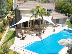Shade sails with pool. Love the idea; not sure if we can pull it off given wind issues.