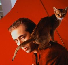 Nicholas Cage -- though I'm not personally a fan, I had to post him because the entire Copolla family are known for their cat love.  His brother drives a motorcycle with his Burmese riding in a special seat in the front.