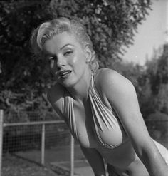 """Photograph of Marilyn Monroe in bombshell bathing beauty mode. Taken October 10th, 1950 by Bob Beerman, a staff photographer at Modern Screen.  The images from this photo shoot won Screen Album Magazine's """"outstanding pin-up photo of the year.""""  Taken..."""