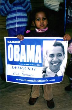 Sasha Obama holds a campaign sign during her father's 2004 bid for the U.S. Senate